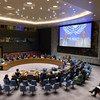 A wide view of the Security Council as Raisedon Zenenga (on screen right), Deputy Special Representative of the Secretary-General for the UN Assistance Mission in Somalia (UNSOM), and Francisco Caetano Jose Madeira (on screen left), Special Representative