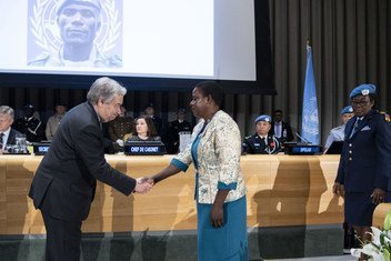 Secretary-General António Guterres bestows Mbaye Diagne Medal to Lachel Chitete Mwenechanya, widow of Private Chancy Chitete, a former UN peacekeeper from Malawi who posthumously received a medal for exceptional courage in the service of peace. (24 May 2019)