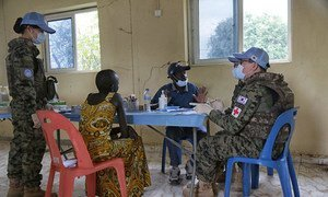 A local woman seeks advice at a medical camp run by South Korean peacekeepers in South Sudan.
