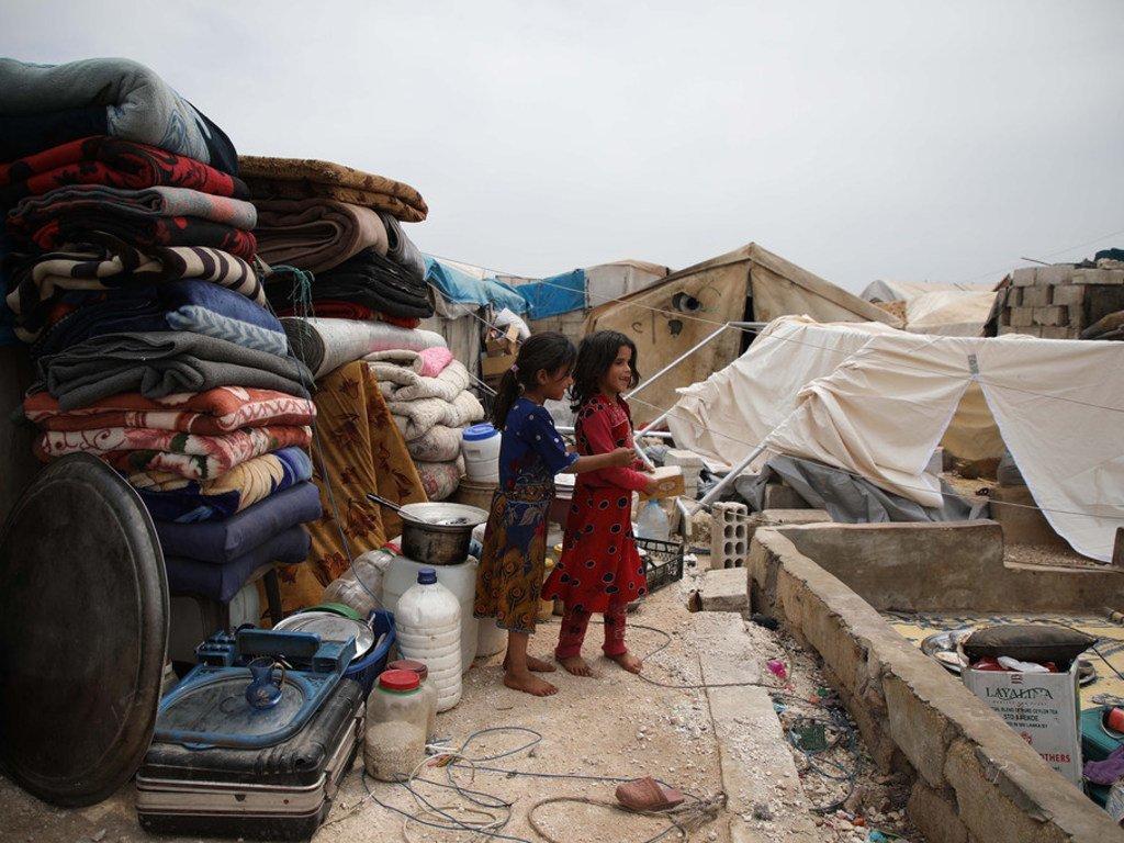 Des enfants ayant fui la violence à Idlib, en Syrie, ont trouvé refuge dans un camp dans le village d'Atmeh, près de la frontière avec la Turquie (mai 2019)