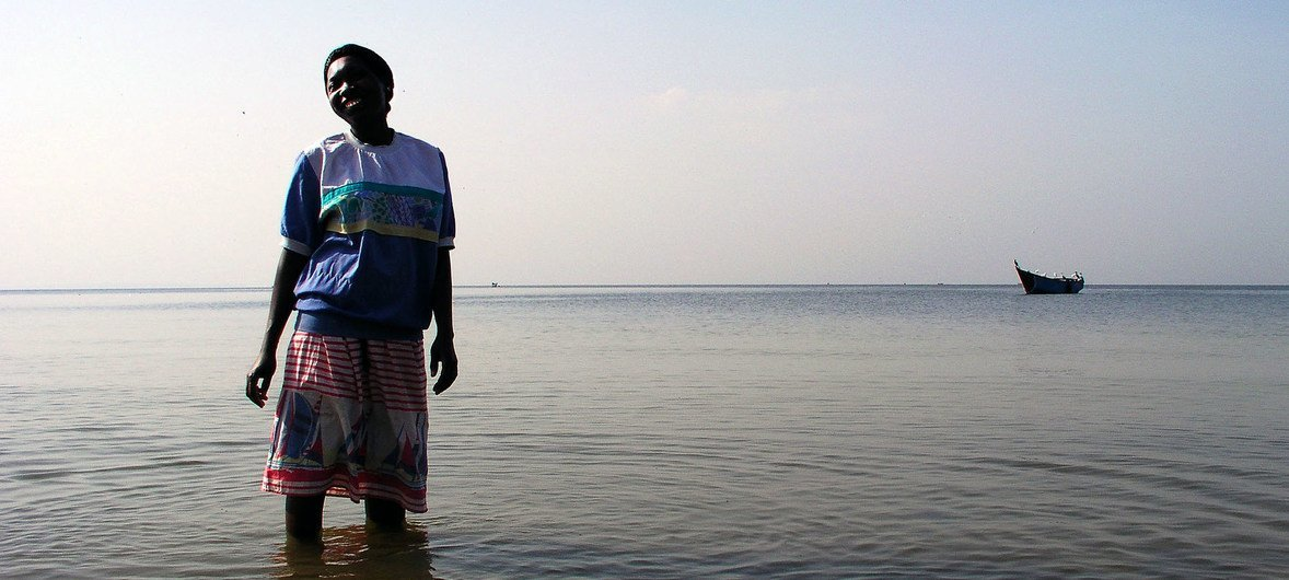 Oceans and seas are home to vast biodiversity.  A woman in Entebbe, is photographed on the shores of Lake Victoria, Uganda.