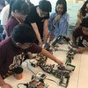 Young students from a robotics team showcase robots at a technology event at the UN. (12 June 2019)