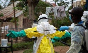 Rinsing Ebola protective gear in Beni, Democratic Republic of the Congo (31 May 2019).