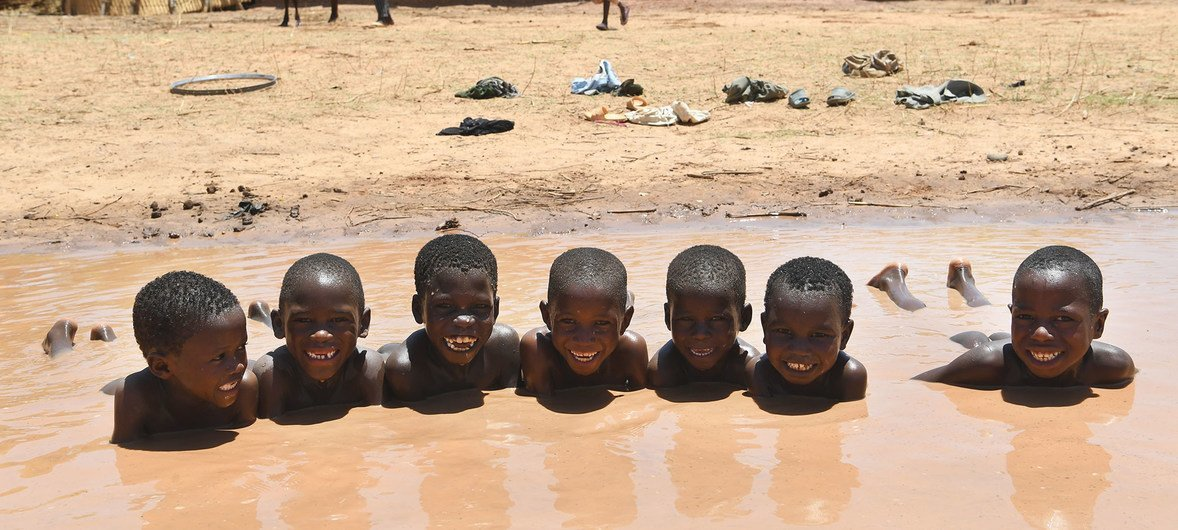 Boys taking a bath and having fun in a pond in Zinder, in the center of Niger. (1 June 2019)