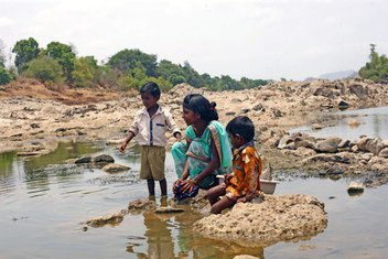 A mother and her two sons wash clothes in Maharashtra, India (June 2019).