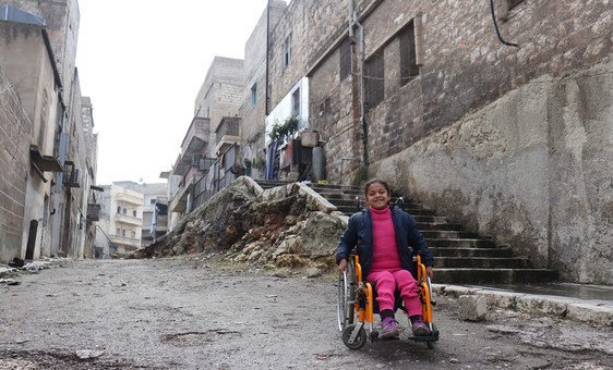 Eight-year-old Hanaa, who was paralysed by an exploding bomb and lost the use of her legs, sits in her wheelchair near her home in East Aleppo City, Syria (28 February 2018)
