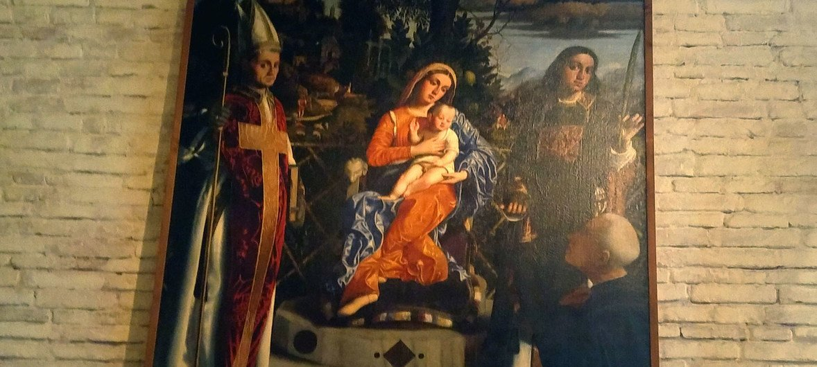Church painting depicting the Blessed Mother holding the Christ Child.
