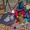 Farhia Mousa sits with three of her six children, including Nacima, 10-days-old, Abdulahi, 4-years-old, and Nasterha, 2-years-old, in a camp for people displaced by conflict and drought in Dangaroyo, Somalia. (22 May 2019)