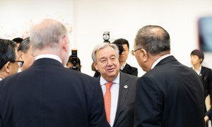 UN Secretary-General António Guterres at the G-20 summit in Japan in 2019.  He is shown at the Climate Change Trilateral Meeting with HE Mr. Jean-Yves Le Drian, Foreign Minister of France and HE Mr. Wang Yi, Foreign Minister of China