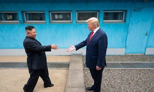 US President Donald Trump shakes hands with the Chairman of the Workers' Party of Korea Kim Jong-un as the two leaders meet at the Korean Demilitarized Zone which separates North and South Korea on 30 June 2019.