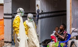 Health workers come to visit mother and daughter, in the quarantine area of the Ebola Teatment Centre of Butembo, North-Kivu province, Democratic Republic of Congo (March 2019).
