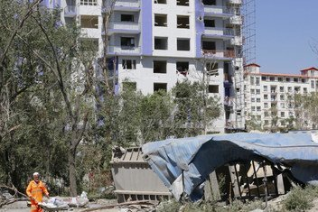 A municipal worker in Kabul, the capital of Afghanistan, cleans debris at an apartment complex that was severely damaged in an attack claimed by the Taliban (file photo)..