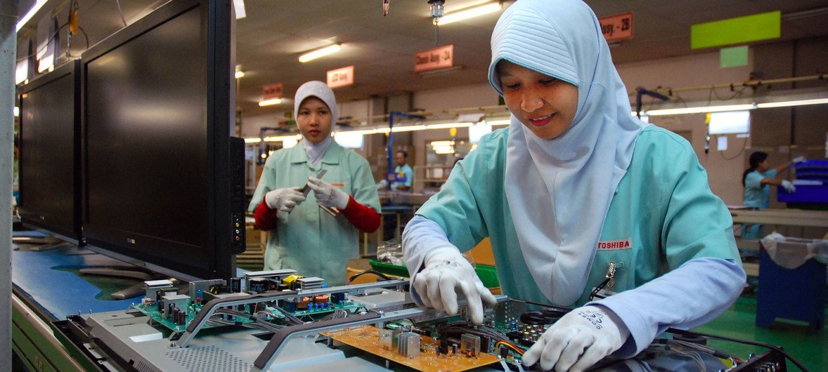Workers assembling and manufacturing electronic goods at a products factory in Indonesia.
