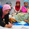 Indonesian women in Yogyakarta discuss village reconstruction during a community meeting.