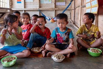 Children in a pre-primary class at Tahouak School in Lao PDR eat nutritious food during their lunch break. (14 March 2019)