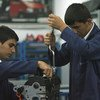 Students work on an engine at Sisli Vocational High School in Istanbul, Turkey.