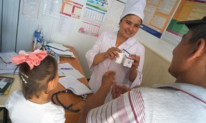 At the UNICEF supported Regional AIDS Centre in Osh in Southern Kyrgyzstan, a female doctor explains proper doses of ARV treatment for HIV. (26 May 2014)