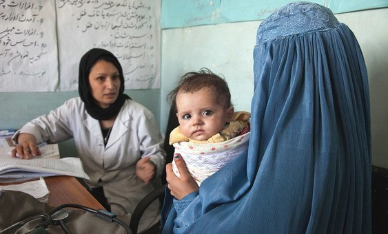 A mid-wife at the Sar-e-Hause medical health clinic in Tajikhan Village, Afghanistan, speaks with a mother and her 5-month-old baby. (10 May 2012)