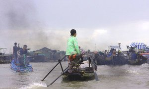 A woman boat-driver in Mekong Delta, Vietnam. (23 July 2014)