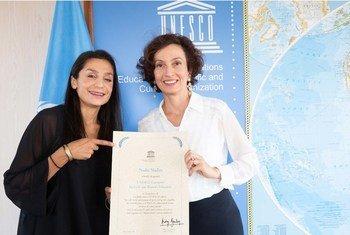 Nadia Nadim, footballeuse danoise d'origine afghane de l'équipe française féminine du Paris Saint-Germain nommée Championne de l'UNESCO pour l'éducation des filles et des femmes