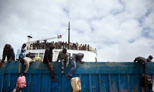 Third Country Nationals unload baggage from an IOM ship as the boat docks in Libya's Benghazi port. (File)