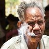 Mr. Bath, 80, is smoking his home grown tobacco in the village of Ban Naseur, Attapeu, Laos.