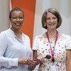 Rhonda King (left) passes the gavel of the ECOSOC presidency to Mona Juul. (25 July 2019)