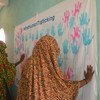Refugee women show their support for UNHCR's anti-trafficking campaign at Wad Sharife camp in east Sudan. (24 July 2018)